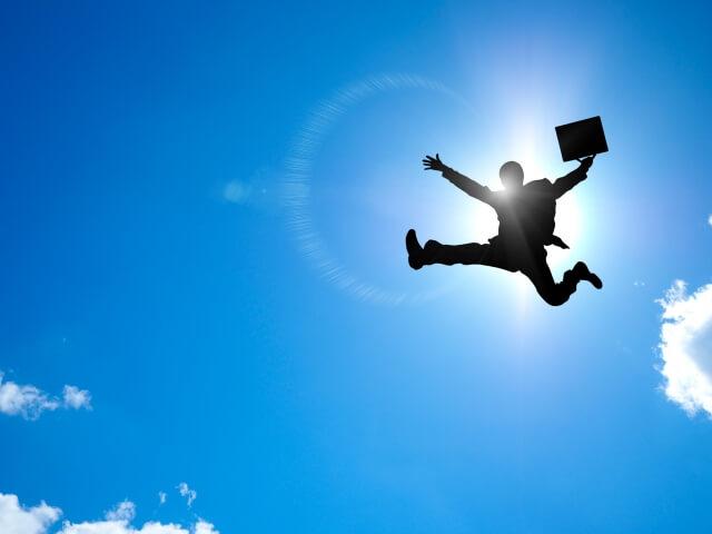 飛躍するサラリーマン画像